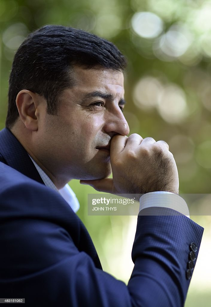 Selahattin Demirtas, co-leader of Turkey's pro-Kurdish People's Democratic Party (HDP), listens to a question during an interview with AFP in Brussels on August 6, 2015. Demirtas urged the world to denounce Ankara's new 'unjust war' on rebel Kurds and asked the EU to push clearly for a truce.