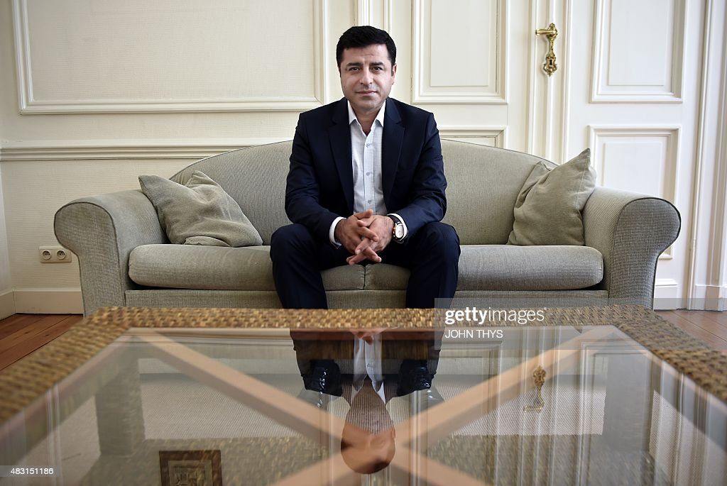 Selahattin Demirtas, co-leader of Turkey's pro-Kurdish People's Democratic Party (HDP), poses during an interview with AFP in Brussels on August 6, 2015. Demirtas urged the world to denounce Ankara's new 'unjust war' on rebel Kurds and asked the EU to push clearly for a truce.