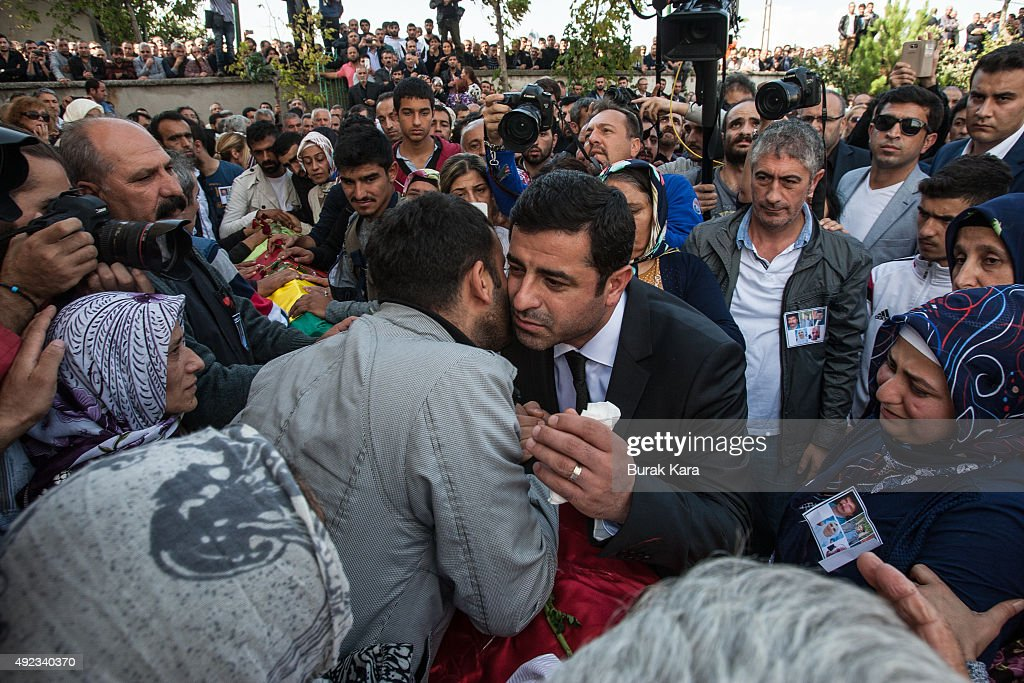 Selahattin Demirtas, (C), leader of the pro Kurdish Democratic Party of Peoples (HDP) attends the funeral of one of the victims of Saturday's bombing attacks on October 12, 2015, in Istanbul, Turkey. Islamic State is the focus of investigations into a twin suicide bombing that killed at least 97 people in the Turkish capital Ankara and investigators are close to identifying one of the suspects, Prime Minister Ahmet Davutoglu said on Monday.