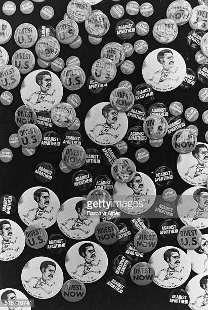 A selction of badges on display at an anti apartheid protest at Columbia University New York City 4th April 1984 The anti apartheid badges have the...