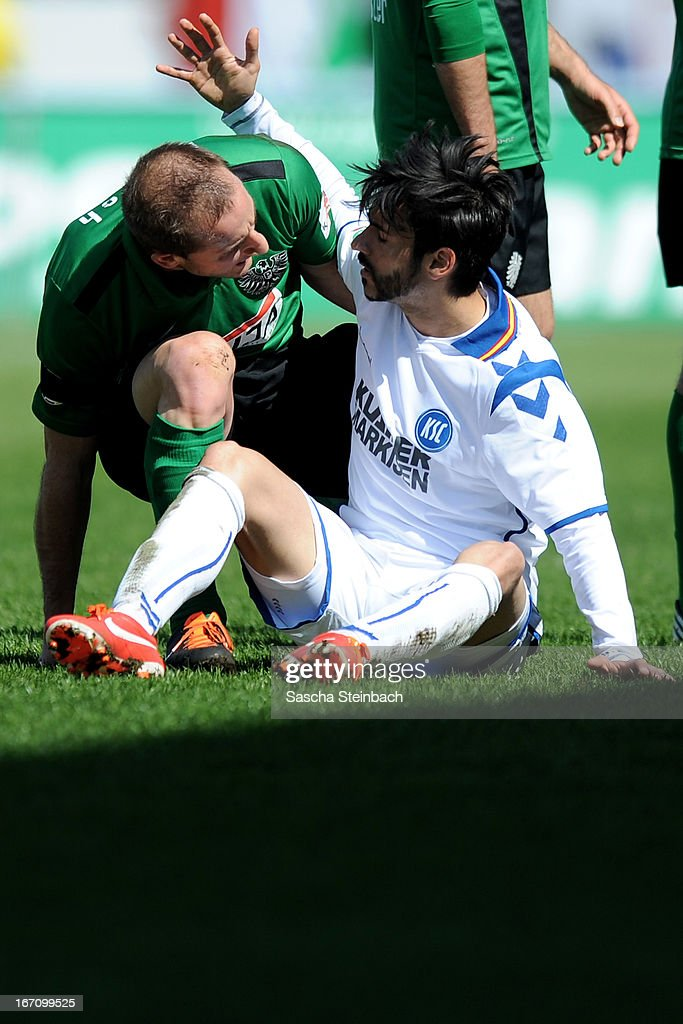 Selcuk Alibaz (R) of Karlsruhe and Patrick Kirsch (L) of Muenster have a disagreement during the 3. Liga match between Preussen Muenster and Karlsruher SC at Preussenstadion on April 20, 2013 in Muenster, Germany.