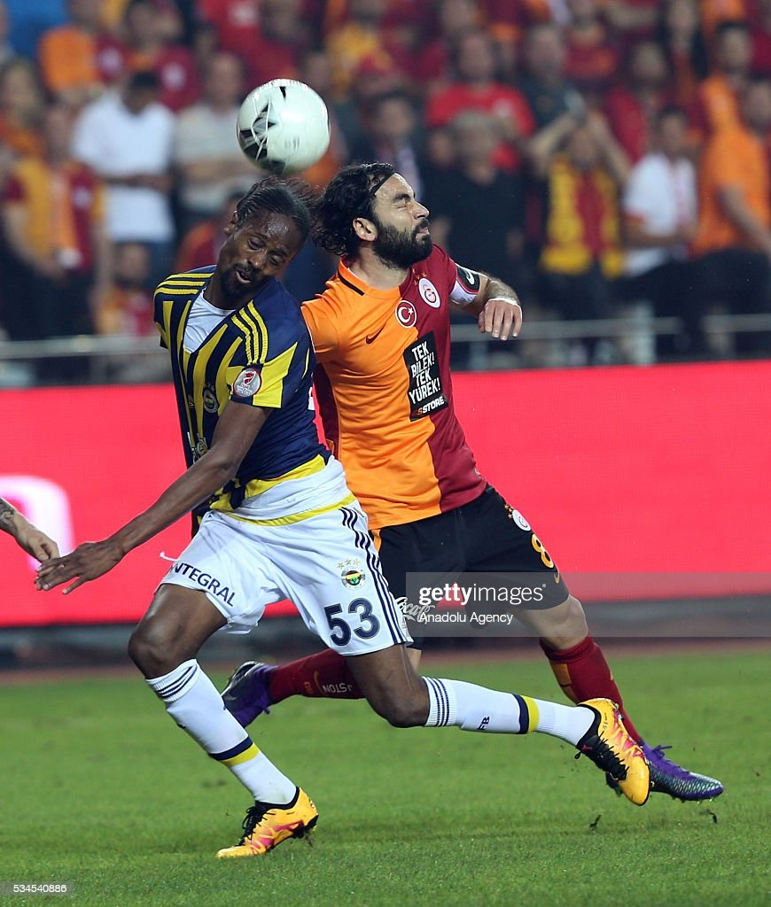 Selcuk Inan (right) of Galatasaray and Abdoulaye Ba (L) of Fenerbahce vie for the ball during the Ziraat Turkish Cup Final match between Galatasaray and Fenerbahce at Antalya Ataturk Stadium in Antalya, Turkey on May 26, 2016.