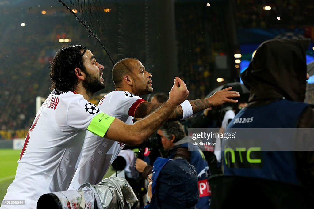 Selcuk Inan of Galatasaray and <a gi-track='captionPersonalityLinkClicked' href=/galleries/search?phrase=Felipe+Melo&family=editorial&specificpeople=646942 ng-click='$event.stopPropagation()'>Felipe Melo</a> of Galatasaray plead with their fans after fireworks are thrown onto the pitch during the UEFA Champions League Group D match between Borussia Dortmund and Galatasaray AS at Signal Iduna Park on November 4, 2014 in Dortmund, Germany.