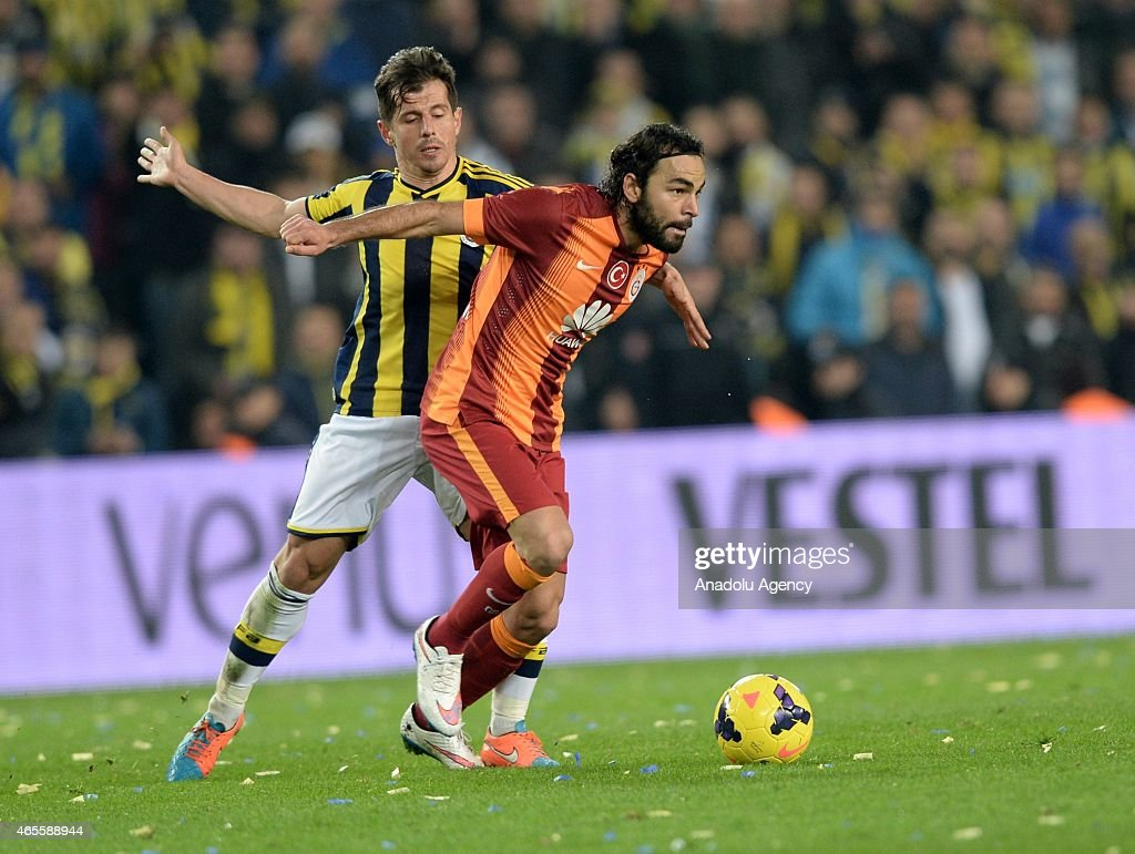 Selcuk Inan (R) of Galatasaray in action against <a gi-track='captionPersonalityLinkClicked' href=/galleries/search?phrase=Emre+Belozoglu&family=editorial&specificpeople=649491 ng-click='$event.stopPropagation()'>Emre Belozoglu</a> of Fenerbahce during Turkish Spor Toto League match between Fenerbahce and Galatasaray at Sukru Saracoglu Stadium in Istanbul, Turkey, on March 8, 2015.