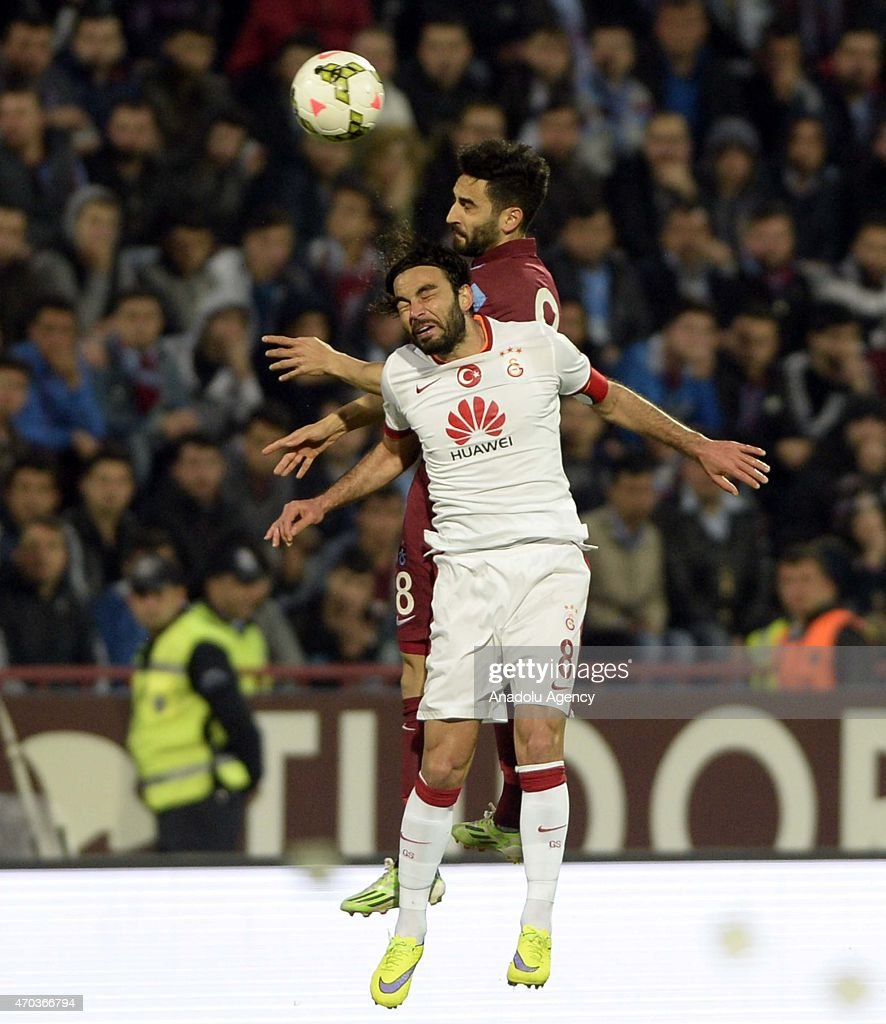 Selcuk Inan (8) of Galatasaray in action against Mehmet Ekici (Rear) of Trabzonspor during the Turkish Spor Toto Super League soccer match between Trabzonspor and Galatasaray at Avni Aker Stadium in Turkey on April 19, 2015.