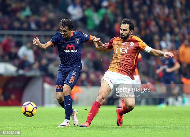 Selcuk Inan of Galatasaray in action against Mossoro of Medipol Basaksehir during the Turkish Spor Toto Super League soccer match between Galatasaray...