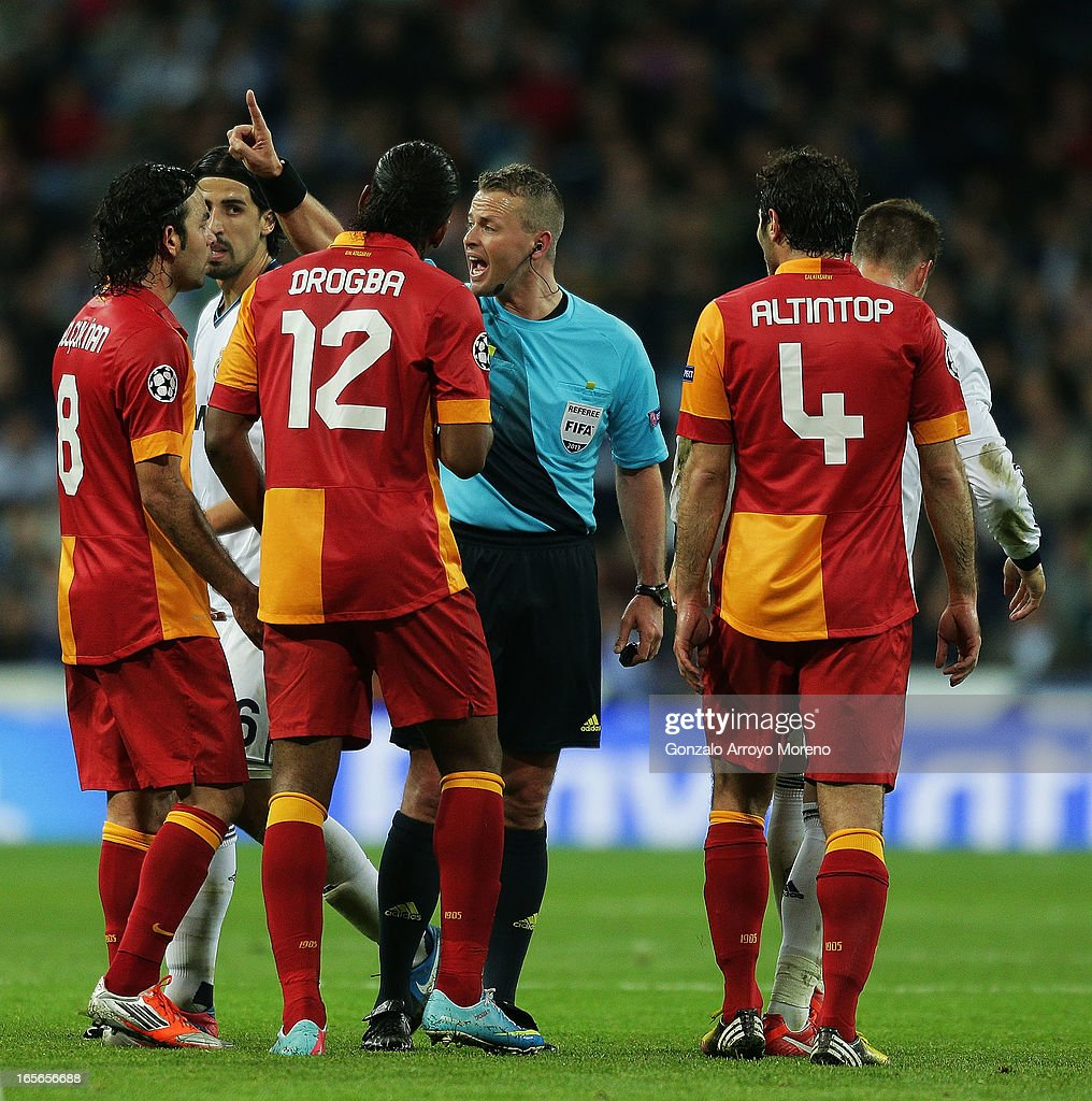 Selcuk Inan (L) of Glatasaray argues with the referee Svein Oddvar Moen (4thL) surrounded by his teammates Didier Dorgba (3dL) and Hamit Altintop (R) as Sami Khedira (2ndL) looks them during the UEFA Champions League Quarter final match between Real Madrid CF and Galatsaray AS first leg at Estadio Santiago Bernabeu on April 3, 2013 in Madrid, Spain.