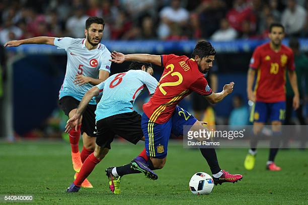 Selcuk Inan of Turkey attempts to tackle Nolito of Spain during the UEFA EURO 2016 Group D match between Spain and Turkey at Allianz Riviera Stadium...