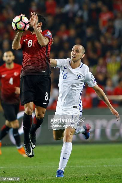 Selcuk Inan of Turkey in action against Sakari Mattila of Finland during the 2018 FIFA World Cup Qualification match between Turkey and Finland at...