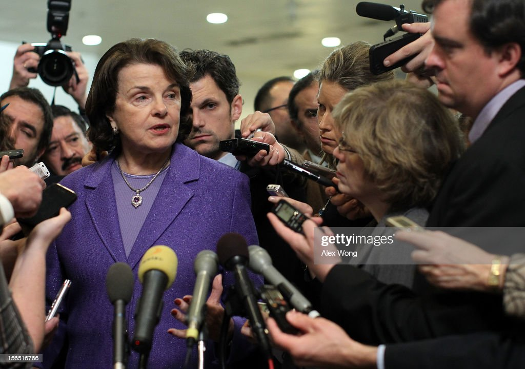 U.S. Select Committee on Intelligence chairwoman Sen. <a gi-track='captionPersonalityLinkClicked' href=/galleries/search?phrase=Dianne+Feinstein&family=editorial&specificpeople=214078 ng-click='$event.stopPropagation()'>Dianne Feinstein</a> (D-CA) speaks to members of the media after a hearing on the Benghazi attack November 16, 2012 on Capitol Hill in Washington, DC. Former Central Intelligence Agency (CIA) Director David Petraeus testified before the committee about the September 11 attacks on the American diplomatic compound in Benghazi, Libya, that killed Ambassador Christopher Stevens and three other Americans.
