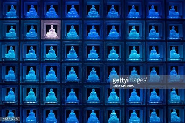 A selected glass buddha alter is seen lit up at the Ruriden columbarium on April 6 2015 in Tokyo Japan The Ruriden operated by the Koukokuji buddhist...