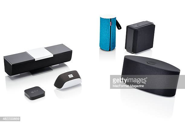 A selection multimedia devices and AirPlay speakers photographed on a white background including Apple TV receiver Onkyo ABXN300 Libratone Zipp...