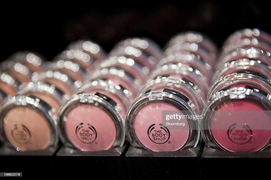 A selection of Body Shop cosmetic blushers as seen on display at a store in Paris, France, on Wednesday, Nov. 21, 2012. Body Shop International Plc Chief Executive Officer Sophie Gasperment has introduced organic lines and updated products like Hemp Hand Protector with Community Fair Trade ingredients after L'Oreal, the world's largest maker of cosmetics, bought the company in 2006. Photographer: Balint Porneczi/Bloomberg via Getty Images