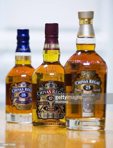 A selection of bottles of aged Chivas Regal whisky sit on display at the Pernod Ricard SA bottling plant in Paisley UK on Thursday Nov 18 2010 Pernod...