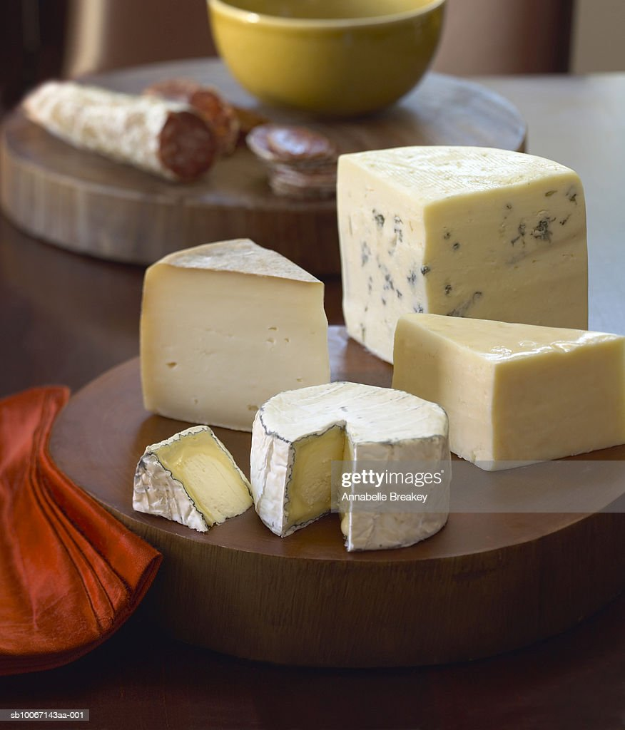 Selection of cheeses on board : Stock Photo