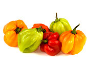 a DSLR royalty free digital image of a selection of colourful hot and spicy Scotch Bonnet chillies isolated against white, using as a cooking ingredient to spice up food and add a hot fiery taste to c