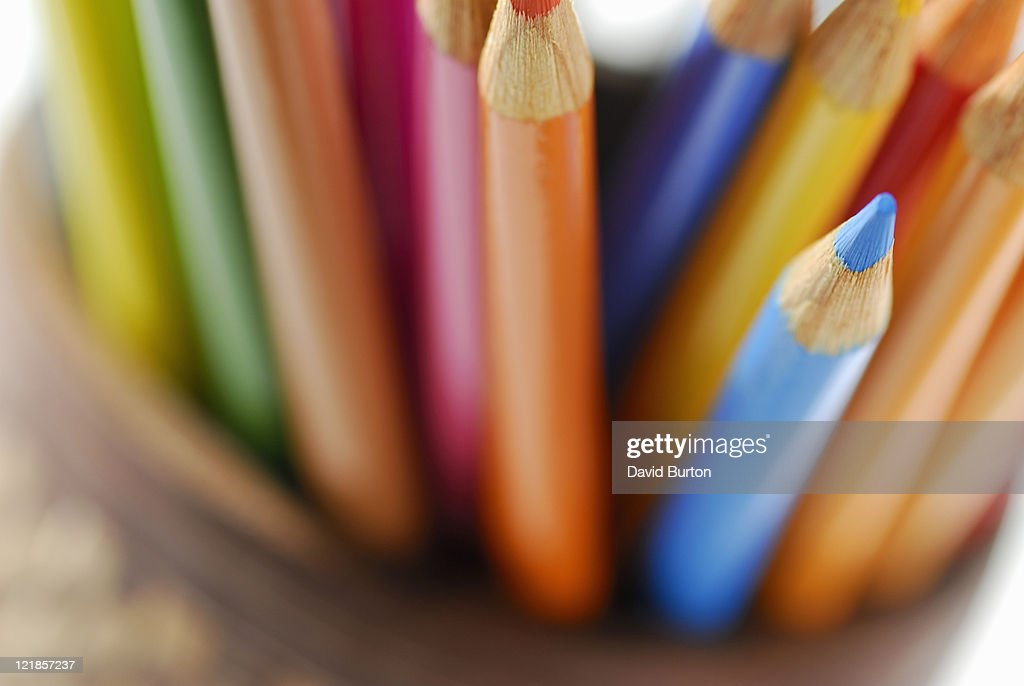 selection of coloured pencils in container