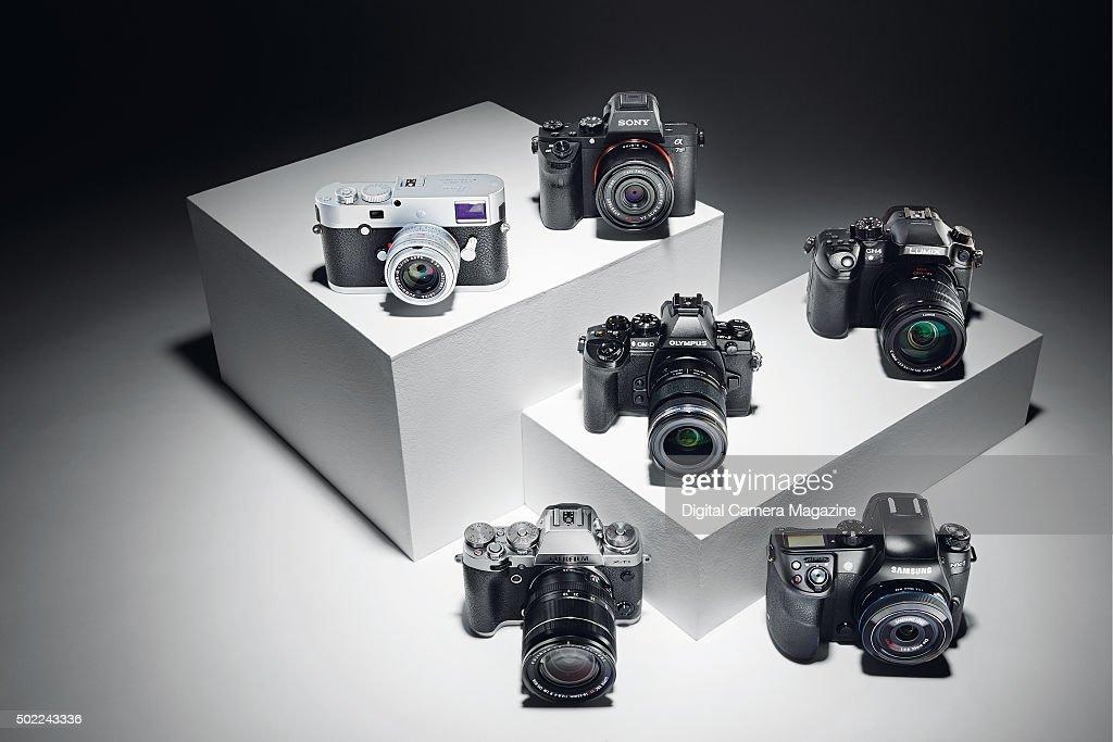 A selection of compact system digital cameras including a Fujifilm XT1 Leica MP Olympus OMD EM1 Panasonic Lumix DMCGH4 Samsung NX1 and Sony Alpha 7...