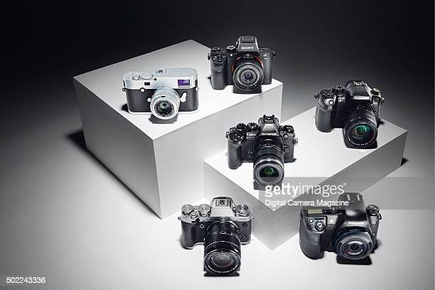 A selection of compact system digital cameras including a Fujifilm XT1 Leica MP Olympus OMD EM1 Panasonic Lumix DMCGH4 Samsung NX1 and Sony Alpha 7...