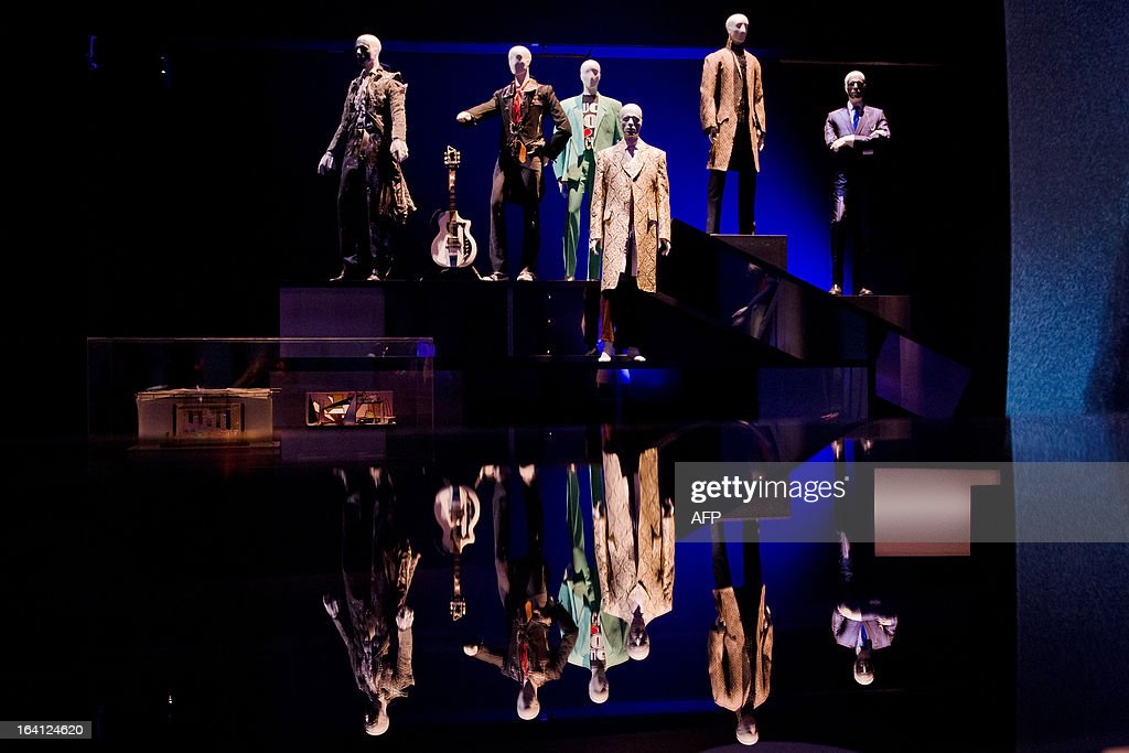 A selection of costumes and outfits worn by musician and actor David Bowie are displayed at the 'David Bowie is' exhibition at the Victoria and Albert (V&A) museum in central London on March 20, 2013. Running March 23 to August 11, the exhibition features more than 300 objects that include handwritten lyrics, original costumes, fashion, photography, film, music videos, set designs and Bowie's own instruments. AFP PHOTO/Leon Neal