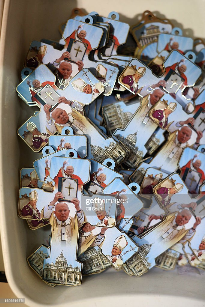 A selection of crucifixes bearing the image of the Pope John Paul II are displayed for sale on February 25, 2013 in Rome, Italy. The Pontiff will hold his last weekly public audience on February 27, 2013 before he retires the following day. Pope Benedict XVI has been the leader of the Catholic Church for eight years and is the first Pope to retire since 1415. He cites ailing health as his reason for retirement and will spend the rest of his life in solitude away from public engagements.