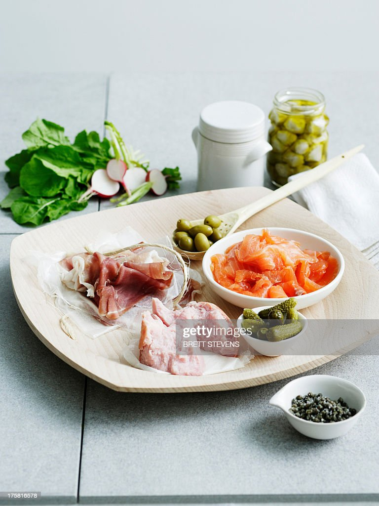 Selection of cured meats and pickles : Stock Photo