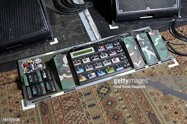 A selection of electric guitar effects pedals used by Stephen Carpenter of American alternative metal band Deftones photographed during a shoot for...