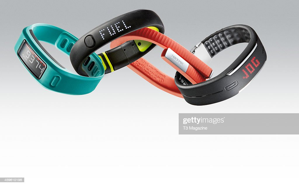 A selection of fitness tracker bracelets including a Garmin Vivofit Nike FuelBand SE Jawbone UP24 and Polar Loop taken on March 27 2014