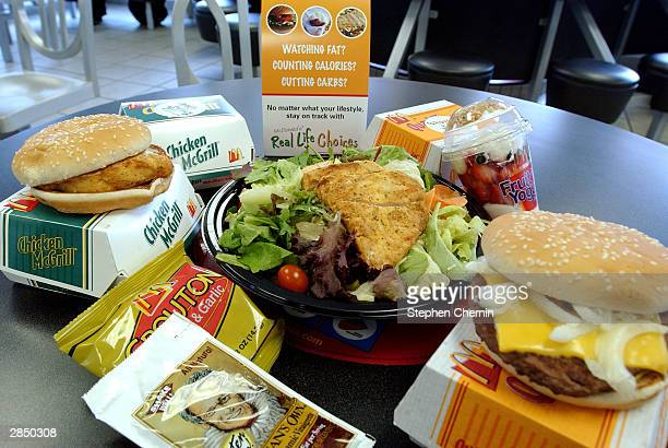 A selection of foods from McDonald's new 'Real Life Choices' menu are displayed January 7 2004 in New York City The fast food giant has developed a...