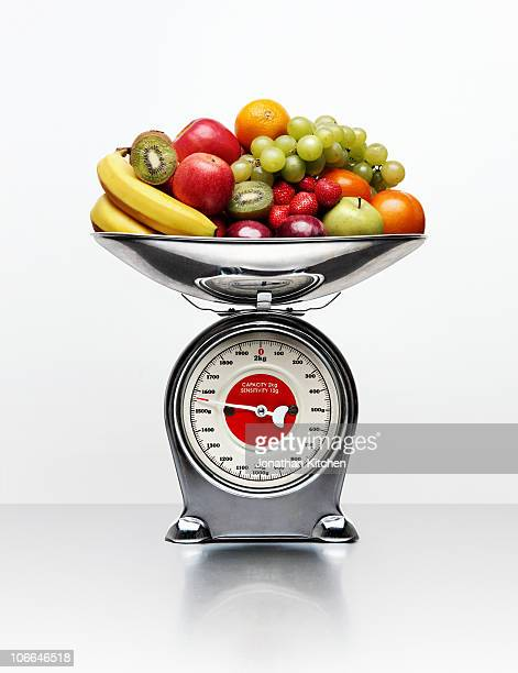 A selection of fruit on a weighing scale