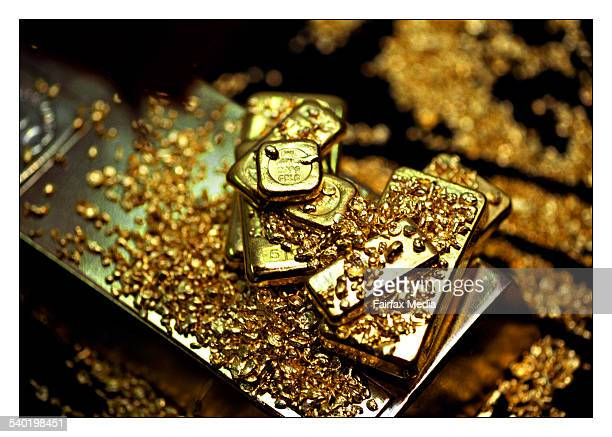 A selection of gold bars and gold flakes