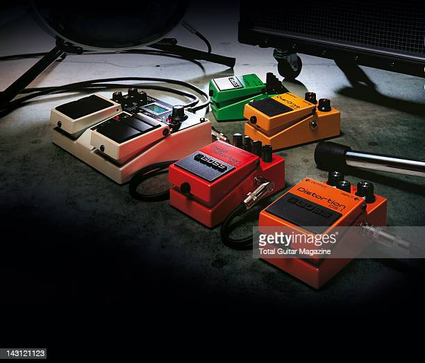 A selection of guitar effects pedals on a rehearsal room floor taken on November 15 2007