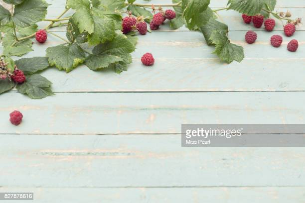 Selection of harvested raspberries on table top