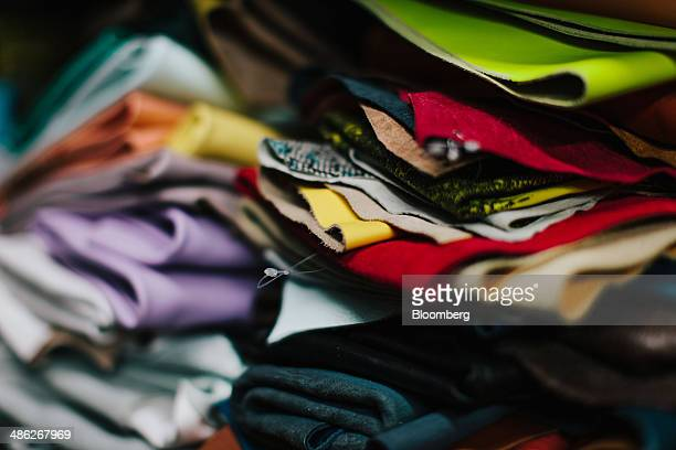 A selection of leather swatches for Rebecca Minkoff handbags sit in a pile at the Baikal manufacturing facility in New York US on Thursday April 17...