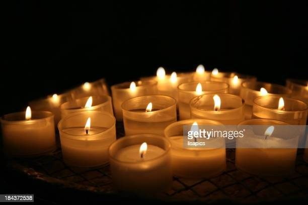 A selection of lit round candles