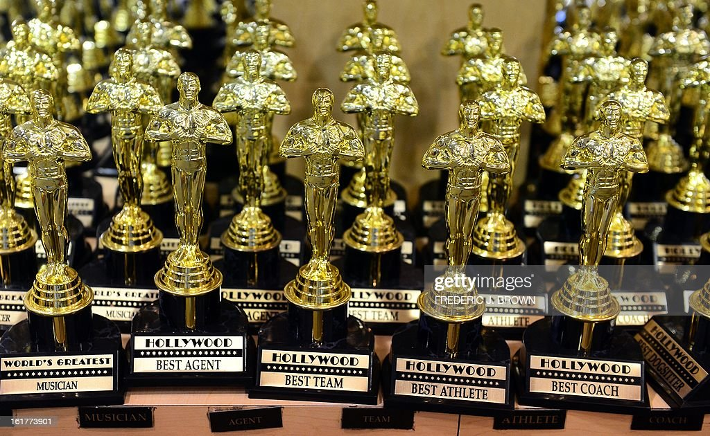 A selection of mini statuettes like those presented to winners of the Academy Award are displayed and for sale at a retail shop catering primarily to...