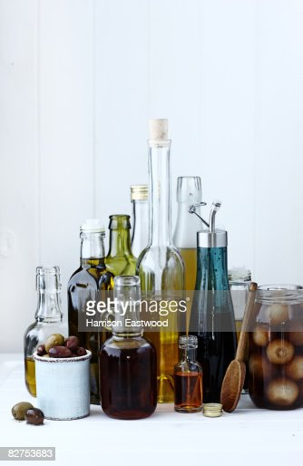 selection of oils and vinegars on kitchen table : Stock Photo