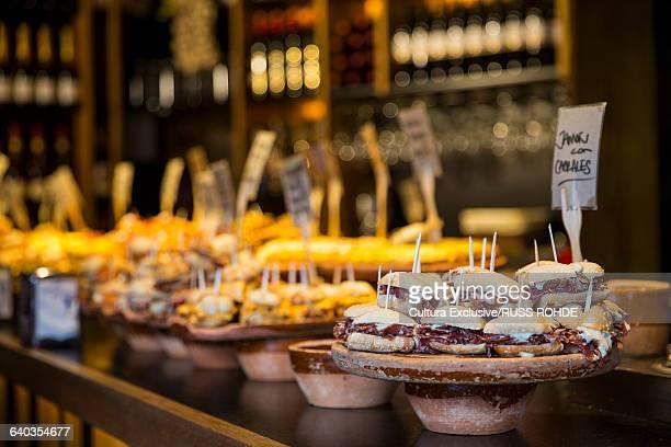 Selection of pintxos tapas on restaurant counter. Bilbao, Spain