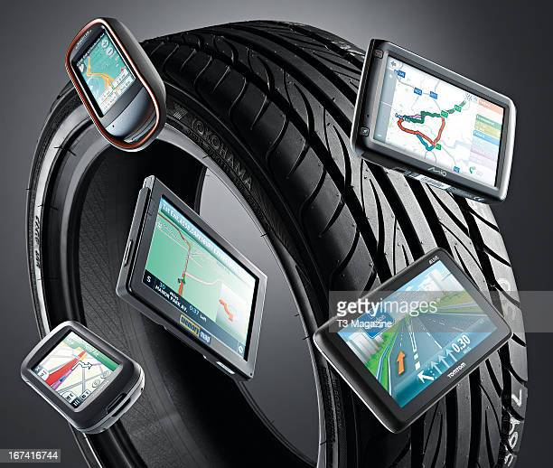 A selection of satellite navigation systems including a Magellan Explorist 710 Mio Spirit 685 TomTom Go Live 1005 Memory Map Adventurer 7000 and...