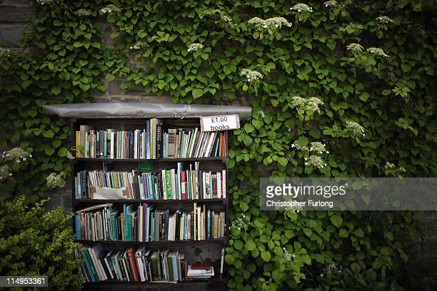 A selection of second hand books nestle against a leaf covered cottage during the Hay Festival on May 31 2011 in HayonWye Wales The small Welsh town...