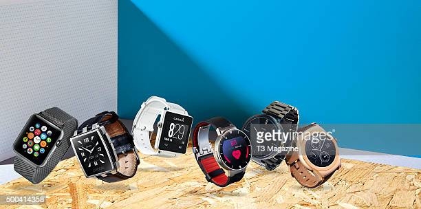 A selection of smart watches including an Apple Watch Pebble Steel Garmin Vivoactive Alcatel OneTouch Motorola Moto 360 and an LG Urbane taken on May...