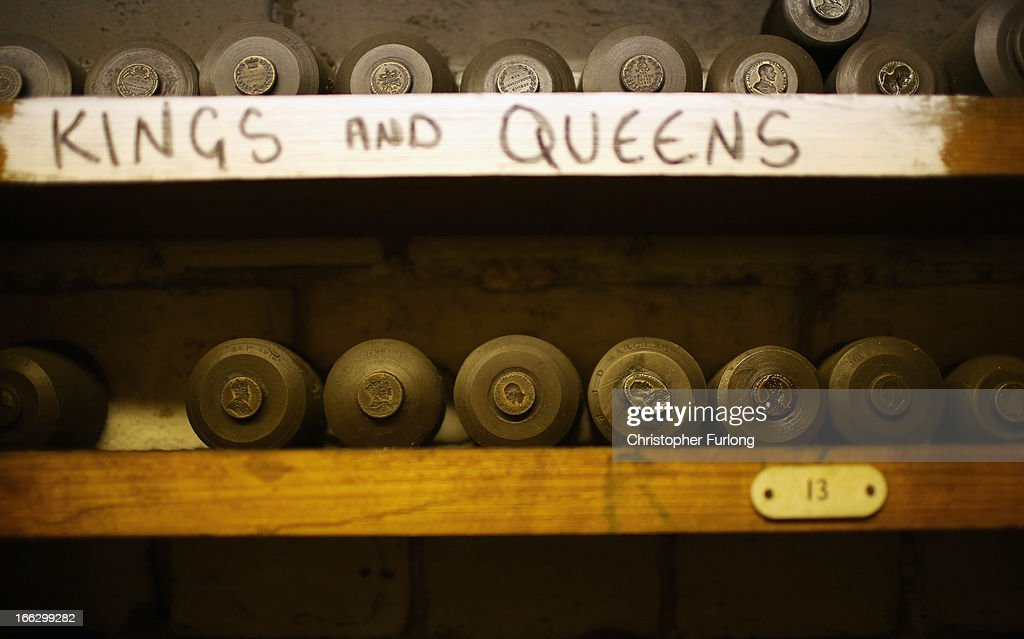 A selection of some of the 250,000 stamping dies are stored on shelves at civil and military regalia manufacturers Toye, Kenning And Spencer on April 10, 2013 in Birmingham, England. Toye, Kenning And Spencer are the oldest fraternal regalia manufacturers in the world and were established in 1685. From their factories in Birmingham and Bedworth the company's experts in weaving, gold silversmithing, enamelling and embroidery create a vast array of regalia from civilian and military life.