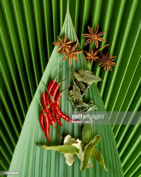 selection of spices on banana leaf