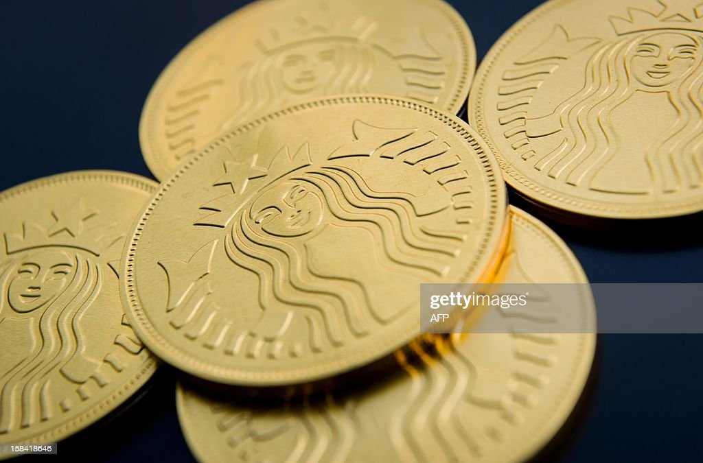 A selection of Starbucks chocolate 'gold coins' are shown displayed at a branch of the international coffee chain in central London on December 16, 2012. AFP PHOTO / LEON NEAL