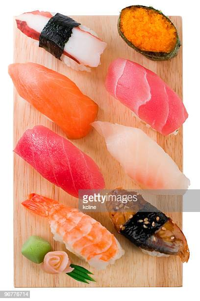 Selection of sushi and sashimi on a wooden board