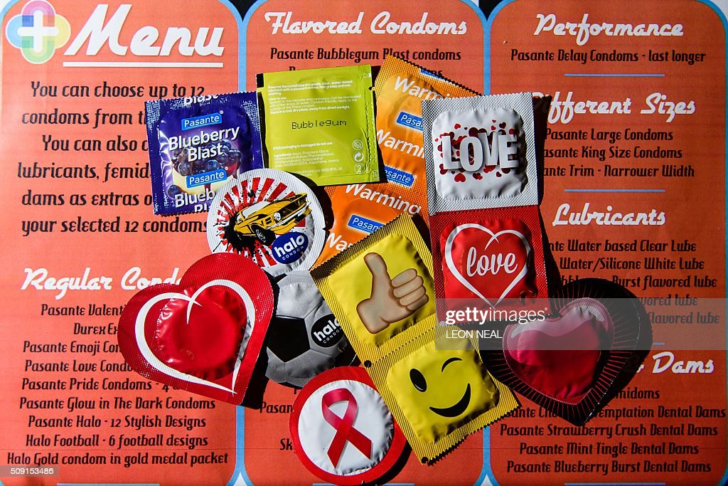 A selection of unusual condoms are displayed at the Valentine's Condom pop-up shop in east London on February 9, 2016. 'Come Correct' are hosting a free pop-up shop leading up to Valentine's day from February 8-13. Come Correct is the London-based condom distribution service where young people can access free condoms using a special 'c-card' in many locations across the capital. The scheme is run by the young people's charity Brook and has over 80 locations across the borough of Hackney where young people can pick up free contraceptives. The condoms are available in a huge range of colours and flavours including 'Blueberry Blast', apple, 'Mint Tingle' and 'Bubblegum Blast'. / AFP / LEON NEAL