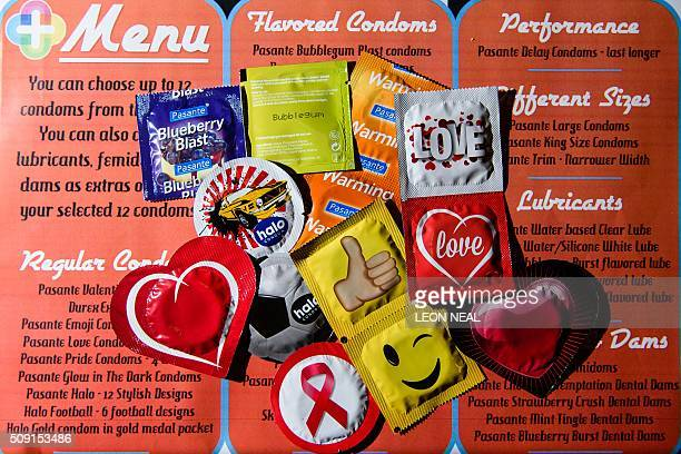 A selection of unusual condoms are displayed at the Valentine's Condom popup shop in east London on February 9 2016 'Come Correct' are hosting a free...