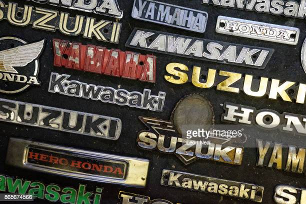 A selection of used badges from Suzuki Yamaha Honda and Kawasaki motorcycles are seen at 'The Bike Hospital' on October 20 2017 in Johannesburg South...