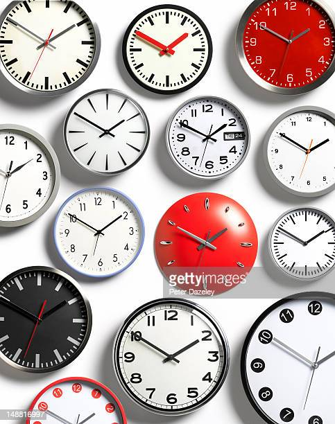 Selection of wall clocks displaying the same time