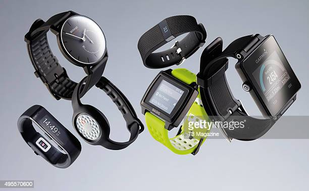 A selection of wearable fitness trackers including a Microsoft Band Withings Activite Pop Jawbone Up Move Fitbit Charge HR Basis Peak and a Garmin...